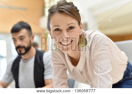 Smiling businesswoman with earings