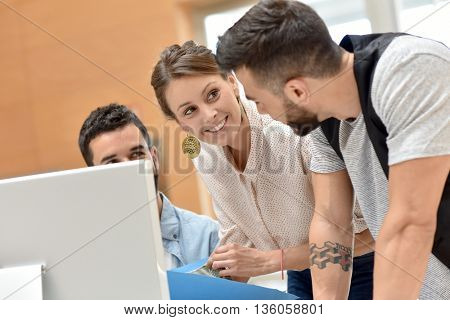 Team of architects working on desktop
