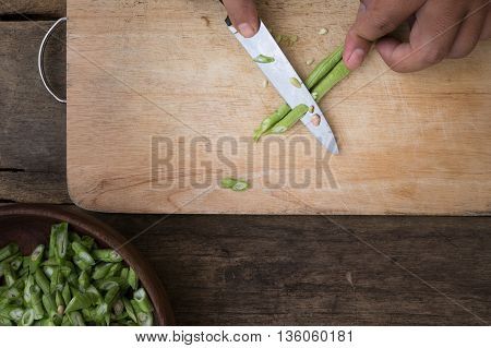 stil life yardlong bean slice on Chopping board wood.