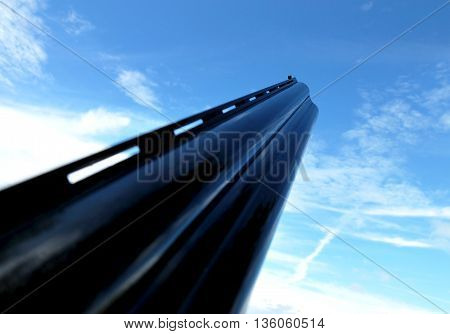 12 gauge shotgun barrel pointing at the sky