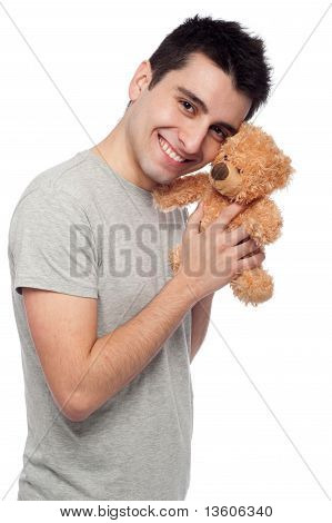 man cuddling a teddy bear