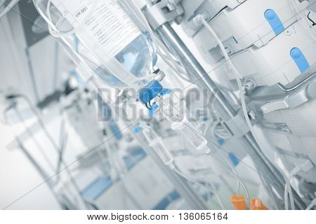 Iv drip in ward on the background of modern equipment.