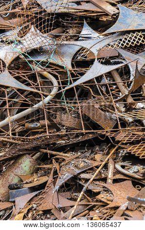 Junk in a pile in a scrap yard.