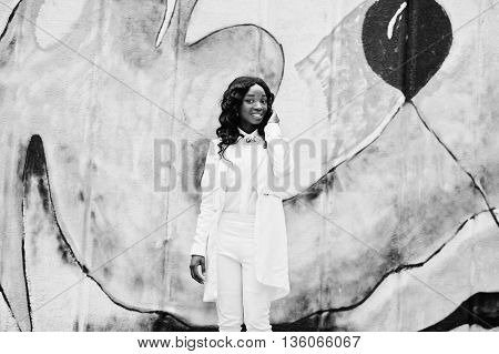 Young African American Girl, Dressed In White, Background Graffiti Wall