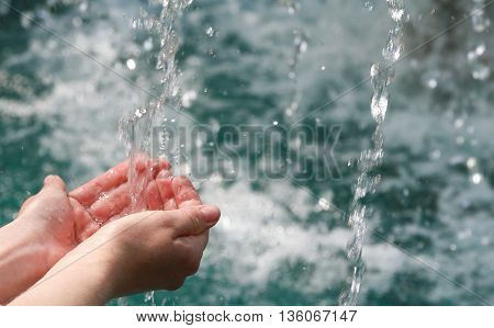 Drinking water & natural water in the hands.