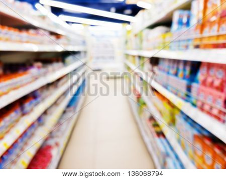 Baby foods jars in store. Blurred image as abstract background