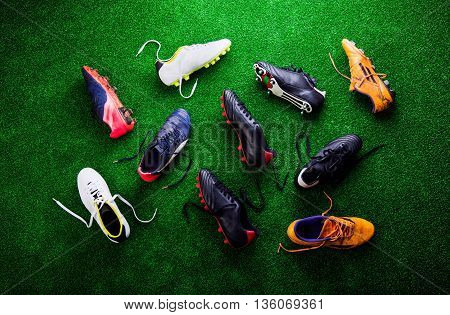 Various Cleats Against Green Artificial Turf, Studio Shot
