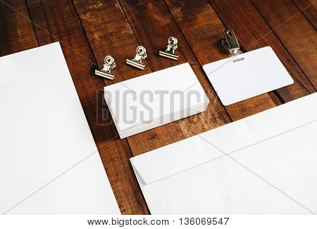 Close-up of blank letterhead business cards and envelope. Blank stationery set on vintage wooden table background. Blank template for your design.