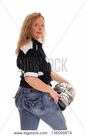 A middle age woman standing in jeans holding her motorcycle helmet isolated for white background.
