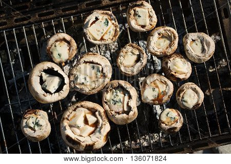 Grilling delicious mushrooms with blue cheese and pork