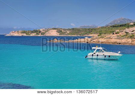 boat on the turquoise sea near Corsica Coast