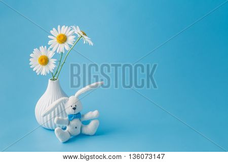 Homemade Toy Rabbit With A Bouquet Of Daisy Flowers