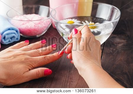 Manicure Applying, Cleaning The Cuticles With Wooden Stick
