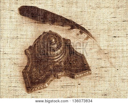 Sepia toned Antique Bronze inkpot with feather on white background with shadows - Photo made with canvas texture effect