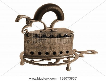 Sepia toned Antique bronze charcoal iron with stand isolated on white background