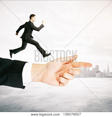 Guidance concept with businessman running on abstract arm pointing forward on misty city background