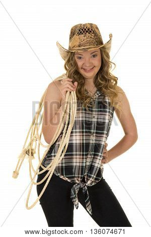 A woman with a funny expression on her face she has down syndrome holding a rope.