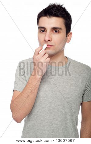 Young Man Applying Lip Balm