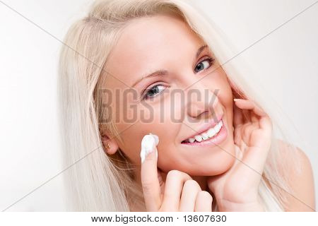 Woman Applying Cream