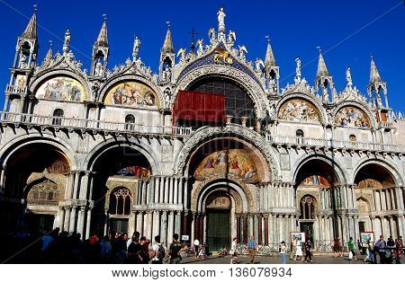 Venice Italy - June 11, 2006: The west front of 11th century Byzantine San Marco Cathedral in Piazza San Marco