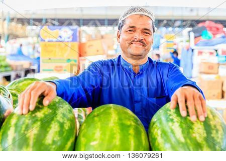 Dubai, June 4, 2016: a vendor with watermelons at the fruit and vegetable market in Dubai, UAE