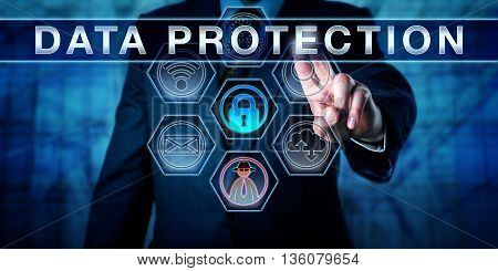 Business manager is pressing DATA PROTECTION on an interactive touch screen interface. Information privacy metaphor and corporate challenge concept for data privacy in networks and cyber space.