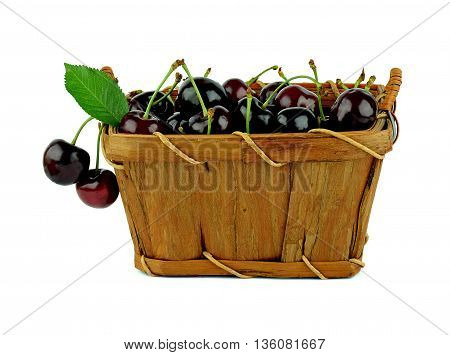 A basket of fresh cherries with leaves. Summer season. Healthy eating. Diet. Artisan Food. / Isolation on a white background /.
