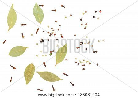 Clove paprika and bay leaf on white background