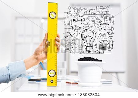 Hand of business person measuring with ruler plan for income growth