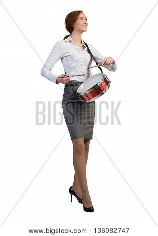 Funny businesswoman playing drums isolated on white background