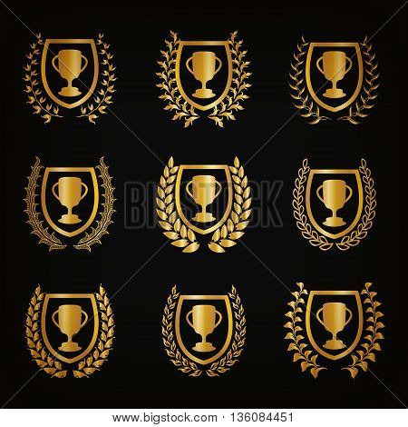 Set of luxury golden shields with laurel wreaths, champion cups. Royal heraldic elements, award, emblem, icon, symbol, label, badge, blazon, medal, logo for web, page design Vector illustration EPS10