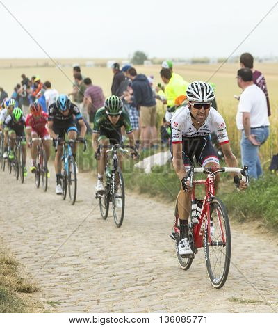 Quievy, France - July 07 2015: The Spanish cyclist Haimar Zubeldia of Trek Factory Racing Team riding in the peloton on a cobblestone road during the stage 4 of Le Tour de France 2015 in Quievy France on 07 July2015.