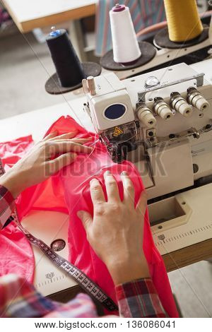 Tailor Sewing Fabric At Factory