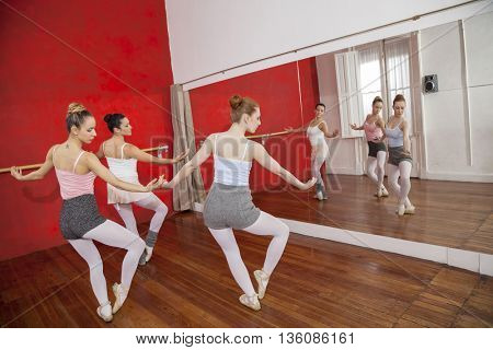 Ballerinas Dancing In Front Of Mirror At Studio