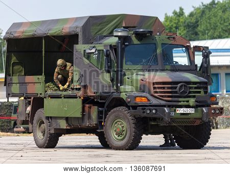 BURG / GERMANY - JUNE 25, 2016: german army truck, Mercedes-Benz Zetros drives on open day in barrack burg / germany at june 25, 2016. The  Zetros is an off-road truck for extreme operations.