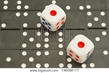 background of black dominoes chips and dices