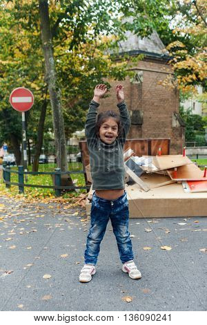 ZAGREB, CROATIA - OCTOBER 14, 2013: Cute Roma girl  posing for camera at garbage dump.