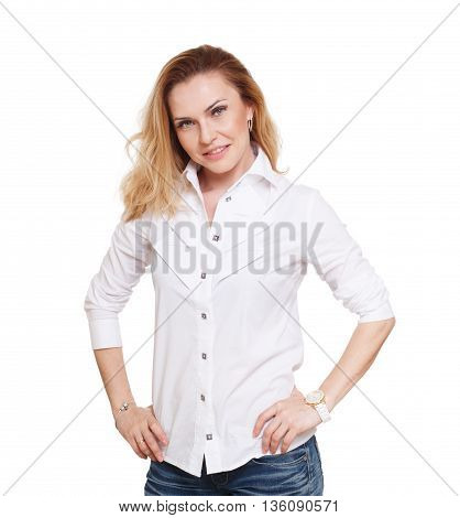 Cheerful caucasian lady posing in white shirt isolated at white background. Blond middle-aged attractive woman looking at camera, self confident and smiling.