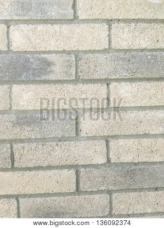 Plain gray brick on the side of a home.