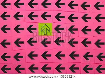 Arrows. Vertical and horizontal concept. Background of pink sticky notes.