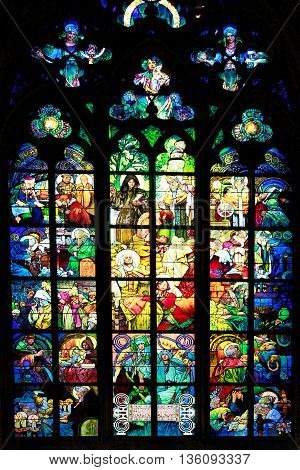 PRAGUE CZECH REPUBLIC - JUNE 05 2016: Stained-glass Window designed by Art Nouveau painter Alfons Mucha in St. Vitus Cathedral Prague Czech Republic