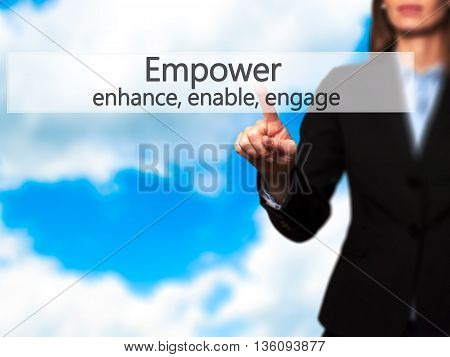 Empower Enhance, Enable, Engage - Businesswoman Hand Pressing Button On Touch Screen Interface.