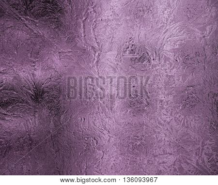 Small frosty patterns on glass in violet tone. Horizontal orientation of a shot