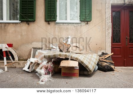 ZAGREB, CROATIA - OCTOBER 14, 2013: Garbage dump placed in front of the house.