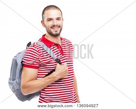 Portrait of a happy male student standing with backpack on white background