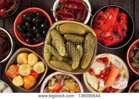 Pickled cucumbers or cornichons, acid or vinegar preserved vegetable