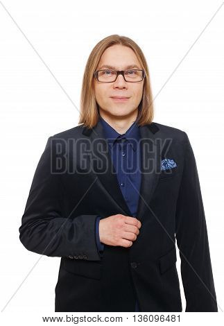Long haired man isolated at white. Portrait of a confident guy looking at camera. Boy style, trendy middle-aged person in glasses and blue suit. Modern businessman.