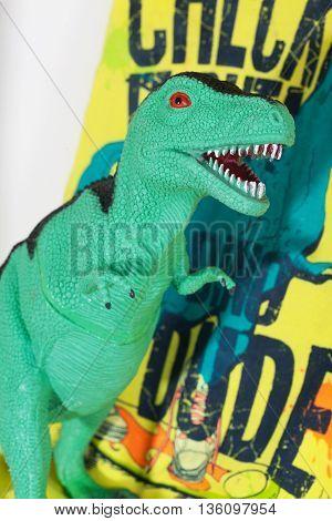 toy dinosaur close up, tyrannosaurus rex, green