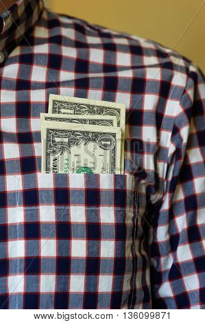Dollars in the shirt pocket, checkerboard cloth