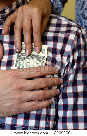 Dollars in the shirt pocket and hands